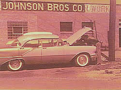 2nd Building in Bellwood, IL, owned by Johnson Bros. Sign painted by Ed Johnson, Jr. Arnie Johnson and his Olds.